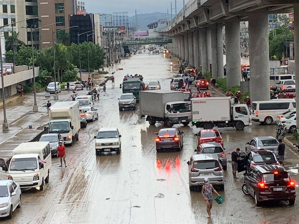 Floods coming out of two malls in Cainta, Rizal, causing motorists stranded along Marcos Highway. Source: ABS-CBN News
