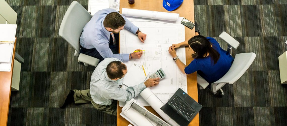 Students in supply chain management program discuss a group project